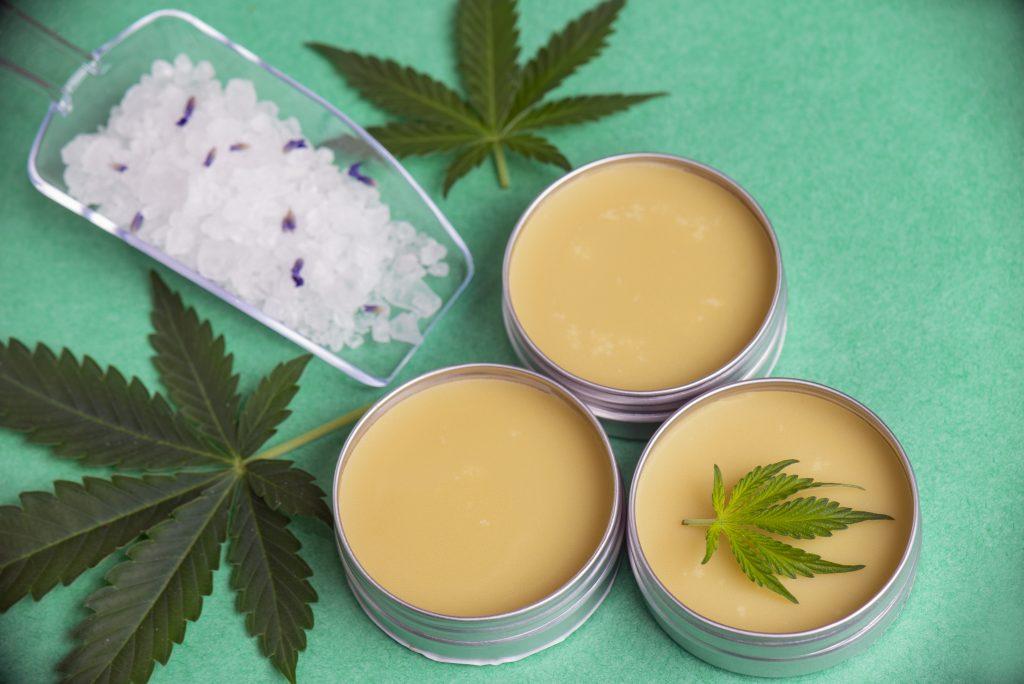 CBD VS CBG Assortment of cannabis wellness products with bath bomb, soaking salts and marijuana salve - cannabis spa concept