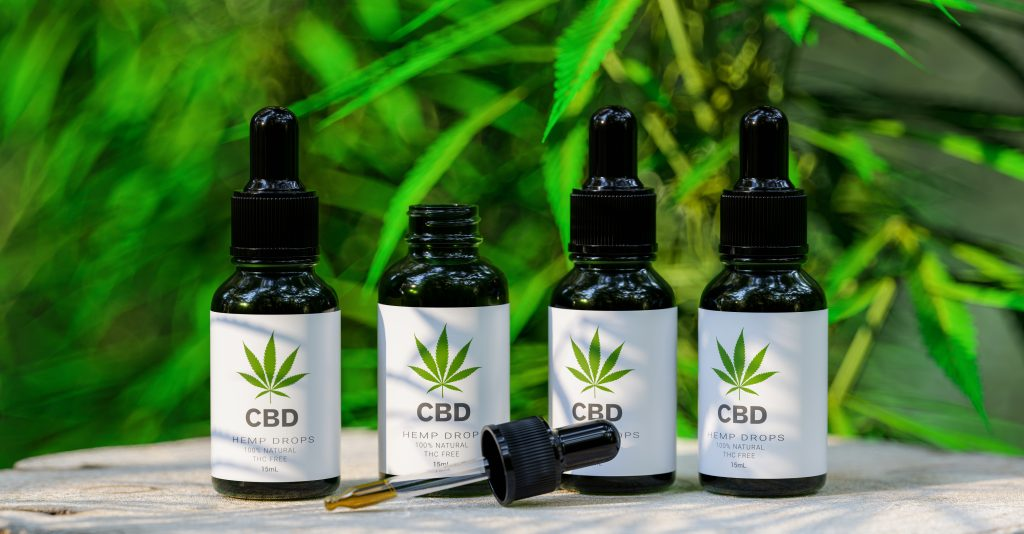 CBD Consumption Forms CBD cannabis OIL bottles. Cannabis oil in pipette, hemp product. Concept of herbal alternative medicine, cbd oil, pharmaceutical industry